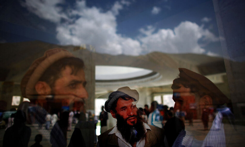 Afghans near the tomb. Massoud supporters say he would have been able to provide much-needed leadership in Afghanistan today. But critics say the selfish and corrupt behavior of some of his followers has tarnished his reputation. (NPR)