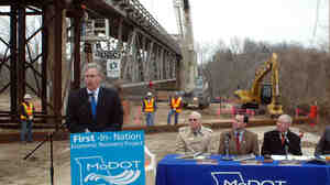 Missouri Gov. Jay Nixon (left) speaks to reporters just before work began on a bridge project near Tuscumbia, Mo., in 2009. The state awarded the contract moments after President Obama signed the 2009 stimulus package.