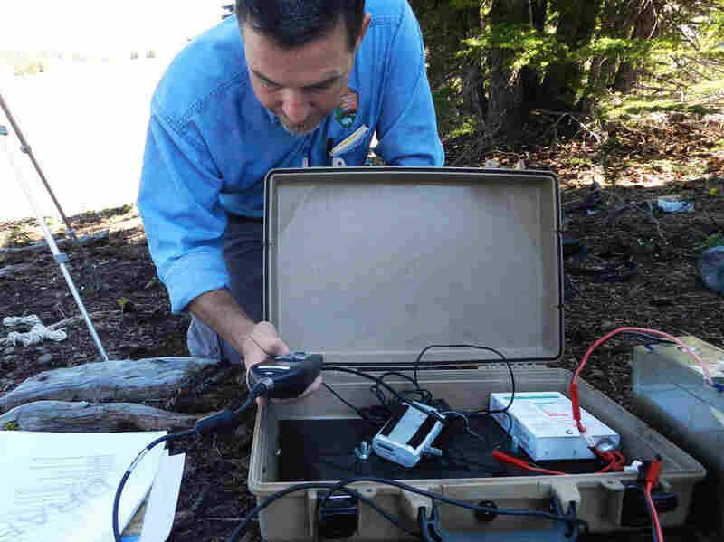 Researcher Chris Wayne sets up recording equipment at Crater Lake.