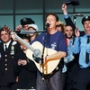 Paul McCartney (center) and other participants, including rock stars, actors and firefighters, sing during the finale of the Concert For New York City at Madison Square Garden on Oct. 20, 2