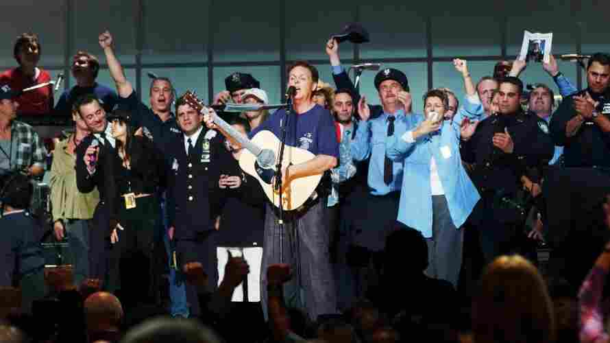 Paul McCartney (center) and other participants, including rock stars, actors and firefighters, sing during the finale of the Concert For New York City at Madison Square Garden on Oct. 20, 2001.