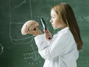 Child staring at brain
