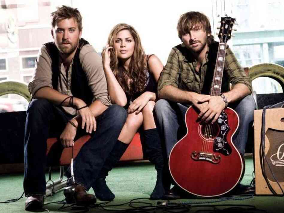 Lady Antebellum's new album is titled Own the Night. Left to right: Charles Kelley, Hilary Scott, Dave Haywood.