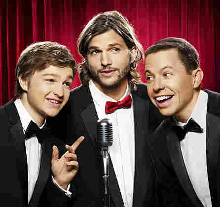 Ashton Kutcher (center) replaces Charlie Sheen on the CBS sitcom Two and a Half Men, which also stars Angus T. Jones (left), and Jon Cryer.