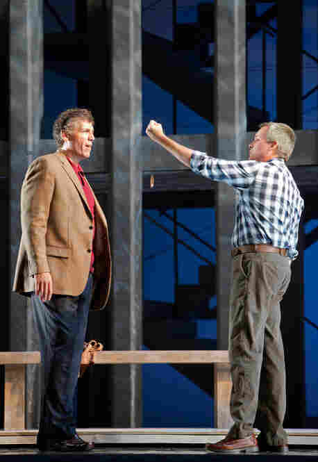 Rick Rescorla (Thomas Hampson, left) accepts a protective talisman from Dan Hill (William Burden) in front ot the World Trade Center.