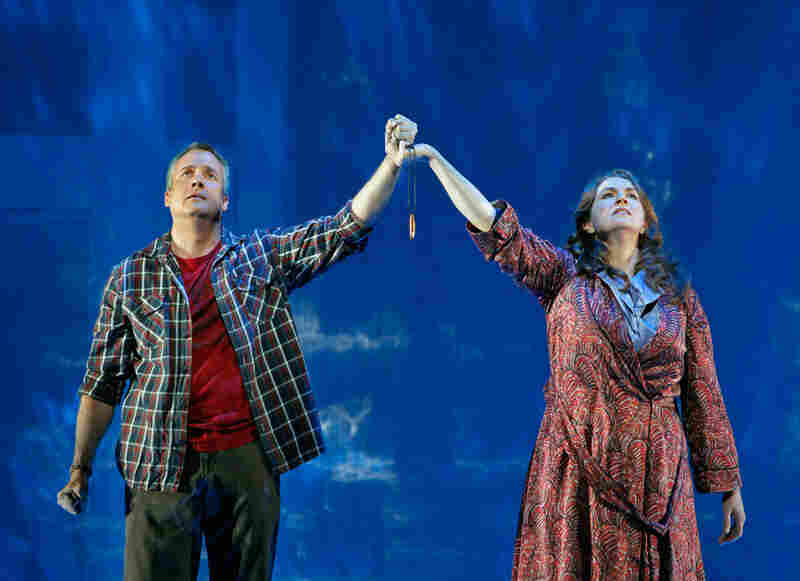 "Susan Rescorla (Melody Moore) and Dan Hill together hold Dan's protective talisman near the end of the opera ""Heart of a Soldier"" at the San Francisco Opera."