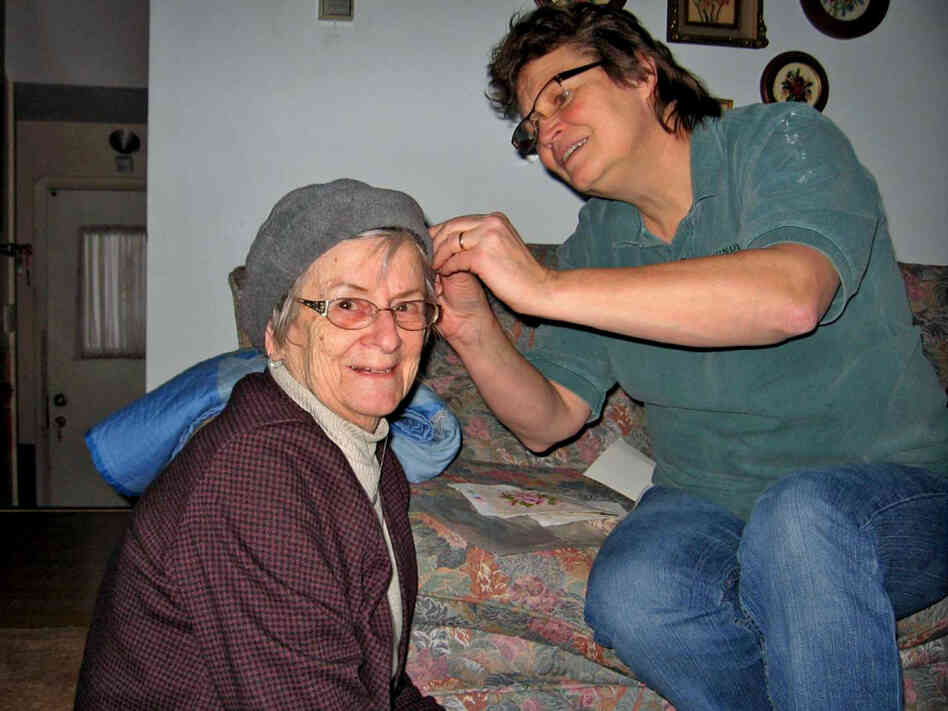 Kate Frego pins the turban of her mother, Aida Essenburg. Before Essenburg died in July of this year, she sat down with a dignity therapist to record the history of  her life in what became a 50-page document.