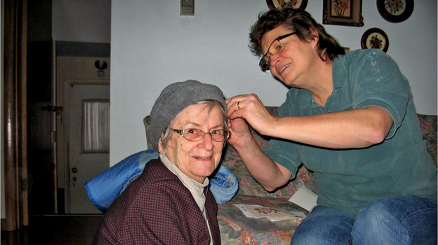 Kate Frego pins the turban of her mother, Aida Essenburg. Before Essenburg died in July of this year, she sat down with a dignity therapist to record the history of  her life in what became a 50-page document. (Courtesy of Kate Frego)