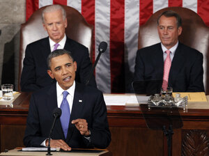 President Obama delivers a speech about creating jobs to a joint session of Congress Thursday as Vice President Biden (left) and House Speaker John Boehner look on.