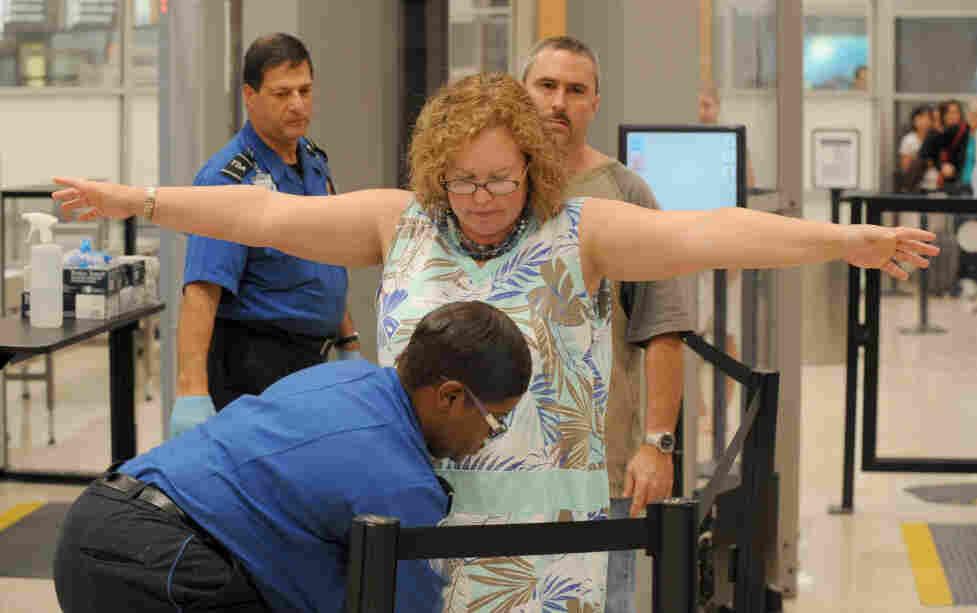Transportation Security Administration screeners check passengers at Hartsfield-Jackson Atlanta International Airport in Atlanta last month. The TSA was created after the Sept. 11, 2001, terrorist attacks.