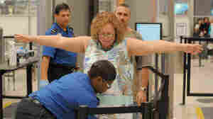 Transportation Security Administration screeners check passengers at Hartsfield-Jackson Atlanta International Airport in Atlanta last month. The TSA was created after the Sept. 11, 2001, terrorist attacks.