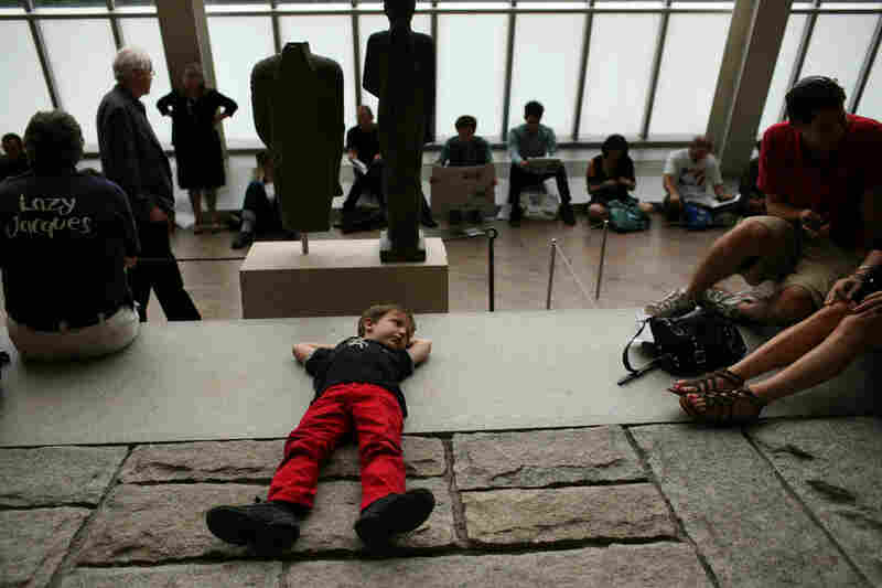 Julian Donas Milstein, 6, relaxes before the Remembering September 11 concert, at The Temple of Dendur at The Metropolitan Museum of Art in Manhattan, NY on September 11, 2011.