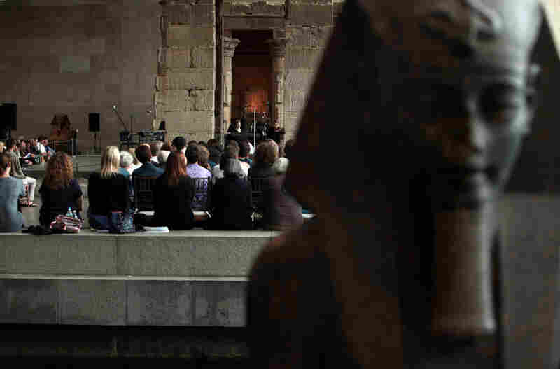 The audience, from across the reflecting pool, at the Remembering September 11 Wordless Music Orchestra concert at The Metropolitan Museum of Art in Manhattan, NY on September 11, 2011.