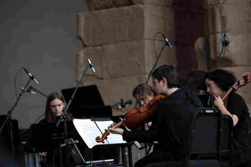 "The quartet plays ""Tenebrae"" by Osvaldo Golijov at the Remembering September 11 concert by the Wordless Music Orchestra conducted by Ryan McAdams presented at The Temple of Dendur at The Metropolitan Museum of Art in Manhattan, NY on September 11, 2011."