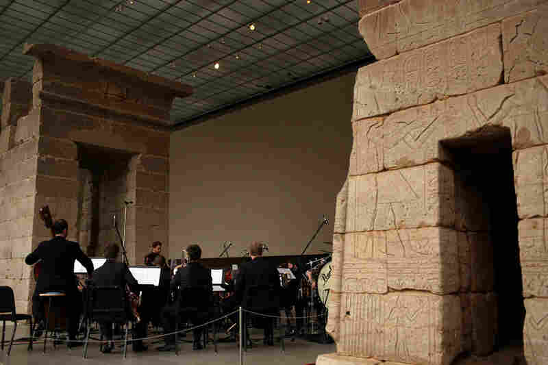 "The Worldless Music Orchcestra, conducted by Ryan McAdams,  plays ""The Disintegration Loops, dlp 1.1"" by William Basinski, orchestrated by Maxim Moston, at the Remembering September 11 concert at The Temple of Dendur at The Metropolitan Museum of Art in Manhattan, NY on September 11, 2011."