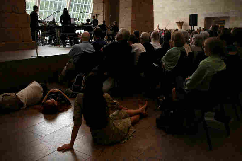 Audience members took to the floor at the Remembering September 11 concert by the Wordless Music Orchestra conducted by Ryan McAdams, presented at The Temple of Dendur in The Sackler Wing at The Metropolitan Museum of Art in Manhattan, NY on September 11, 2011.