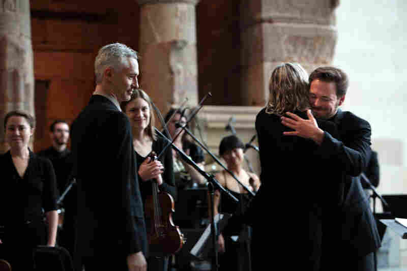 "Conductor Ryan McAdams hugs composer William Basinski after a performance of his ""Disintegration Loops, dlp 1.1"" at the Remembering September 11 Wordless Music Orchestra concert at  The Temple of Dendur in The Metropolitan Museum of Art in Manhattan, NY on September 11, 2011."