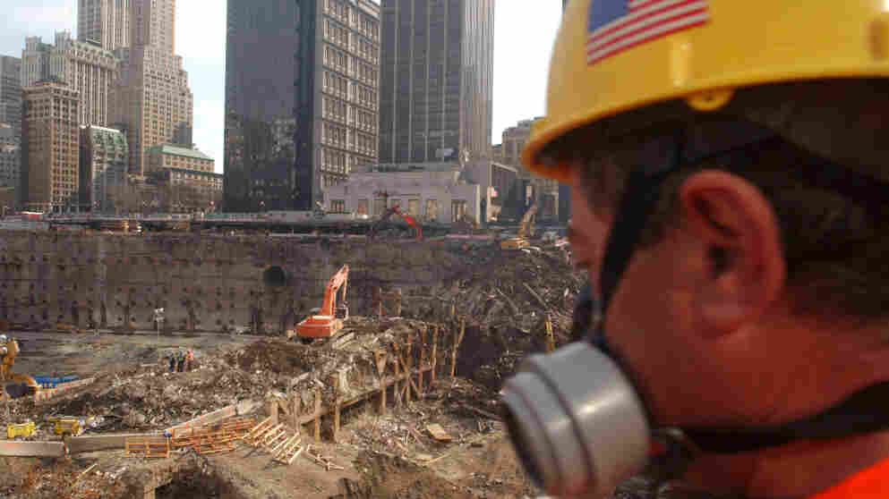 A worker looks over the field of debris of the collapsed south tower area of the World Trade Center in March 2002 in New York City. Many workers chose not to wear the respirators provided for them, except in the most extreme conditions. (Spencer Platt/Getty Images)