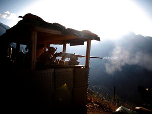 Pfc. Natan Martinez fires a machine gun from a position near the Pakistan border in Afghanistan.