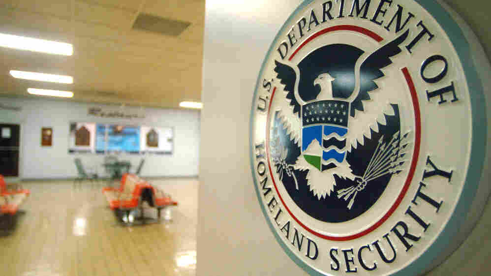 A U.S. Department of Homeland Security sign hangs in an empty terminal at the Tri-State Airport in Ceredo, W.Va.