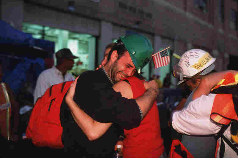 Volunteer rescue workers break down and cry after leaving the World Trade Center site.