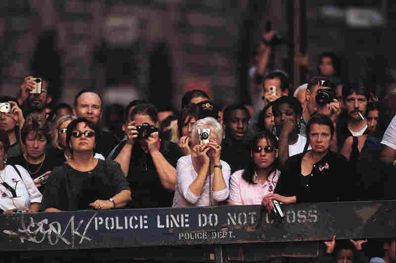 Onlookers watch the clearing work at the remains of the World Trade Center.