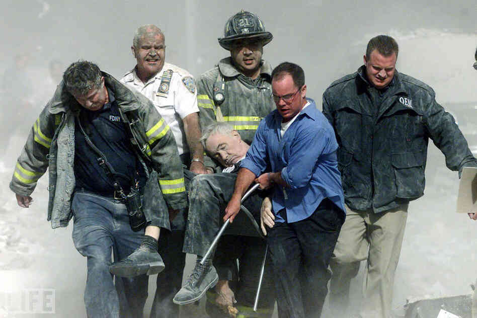 Rescue workers carry mortally injured New York City Fire Department chaplain Mychal Judge from the wreckage after he was killed by falling debris while administer