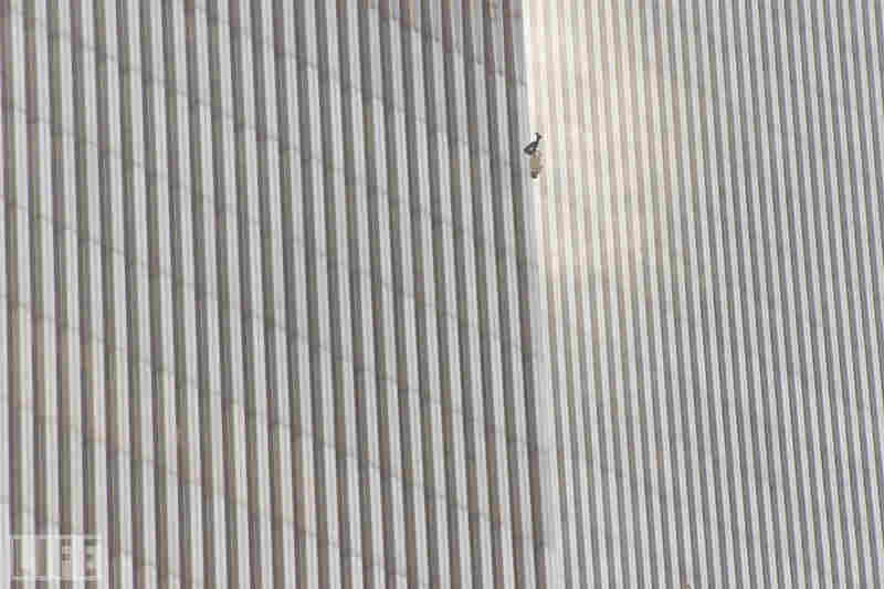 In a scene repeated with terrifying frequency as flames engulfed the tops of the towers, a man falls (or leaps, as was evidently the case with many victims) to his death from the World Trade Center.
