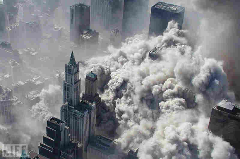 The North Tower collapses, engulfing Lower Manhattan in smoke and ash.