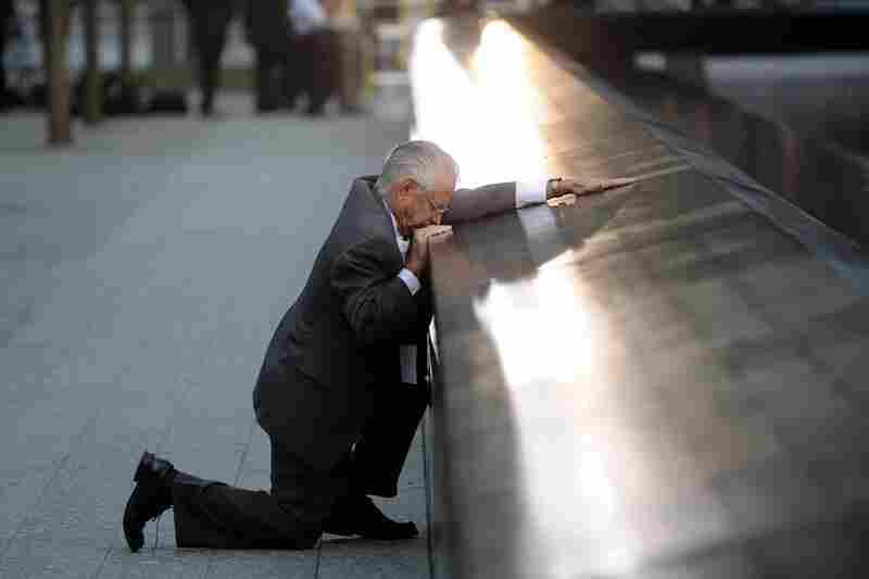 Robert Peraza, who lost his son Robert David Peraza, pauses at his son's name at the 9/11 Memorial.