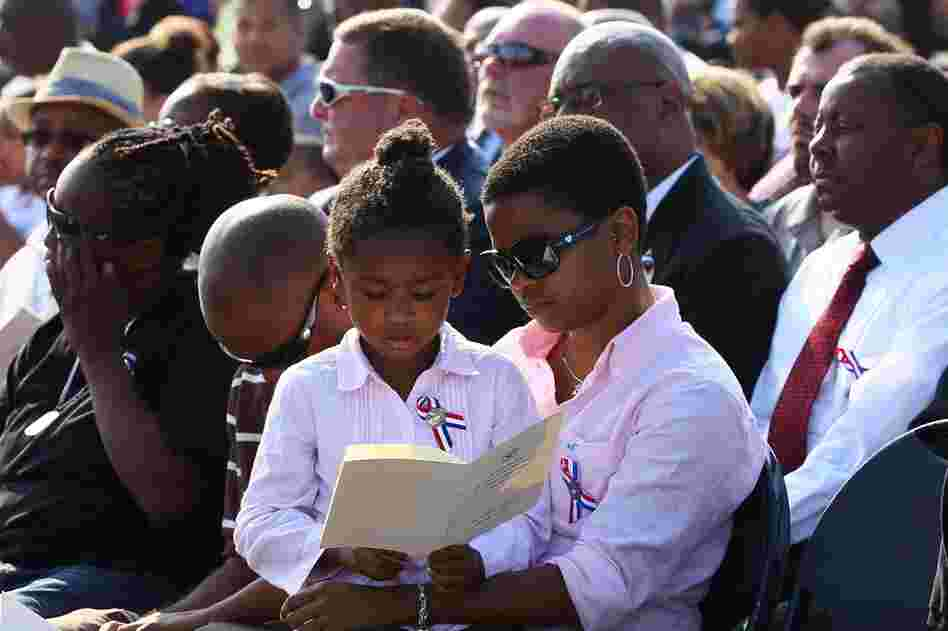 People observe a moment of silence during a ceremony at the Pentagon in Arlington, Va.