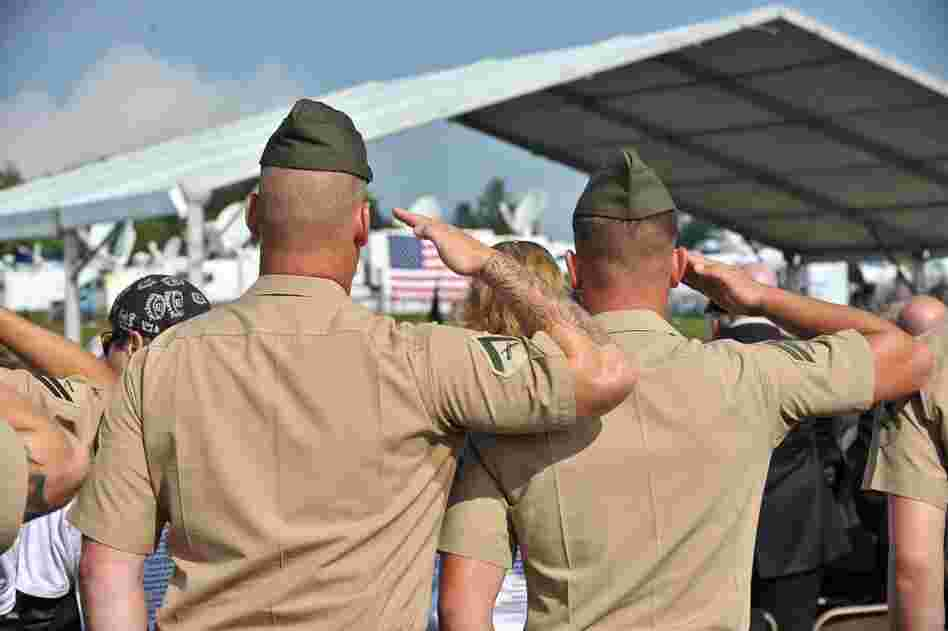 U.S. Marines salute during a ceremony in Shanksville, Pa.