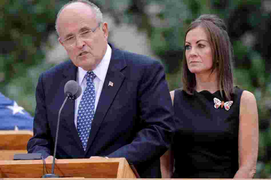Former New York City Mayor Rudolph W. Giuliani (left) speaks with his wife, Judith Nathan, at his side in New York City.