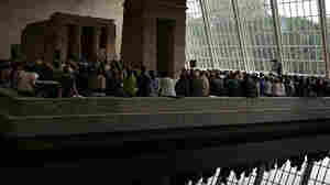 """A view from across the reflecting pool of the """"Remembering September 11"""" concert by the Wordless Music Orchestra — conducted by Ryan McAdams, presented at The Temple of Dendur in The Metropolitan Museum of Art in Manhattan on Sept. 11, 2011."""
