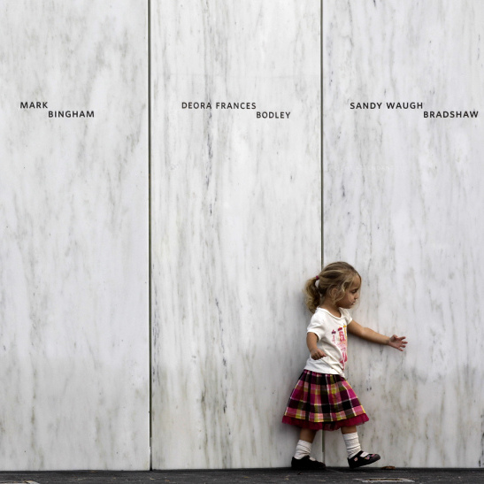 A family member of one of the victims of the crash of United Flight 93 walks along a section of Phase 1 of the permanent National Memorial following its dedication, near the crash site of Flight 93 in Shanksville, Pa.