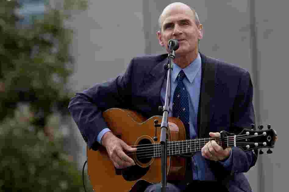 James Taylor performs at the site of the World Trade Center.