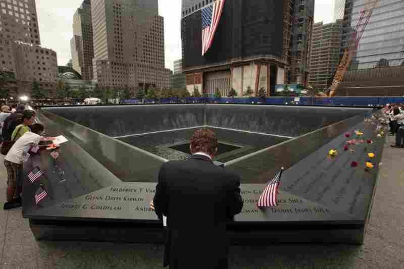 Michael Lehrman, Executive Managing Director of Cantor Fitzgerld and Co., bows his head at the names of some of the over 600 employees from Cantor Fitzgerald who lost their lives in the Sept. 11 attacks, at the 9/11 memorial in New York City.