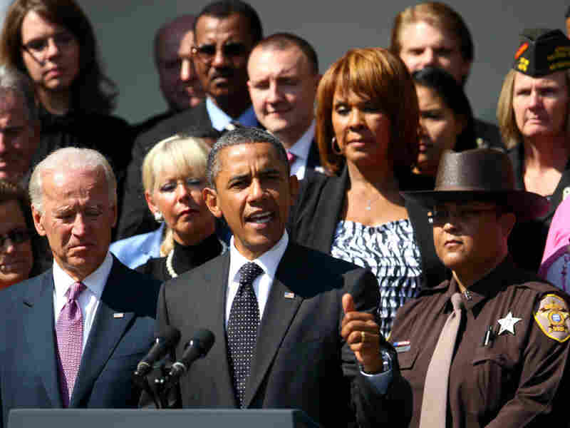 President Obama, flanked by Vice President Joe Biden and teachers, veterans, construction workers, police officers and firefighters, introduces the American Jobs Act in the Rose Garden of the White House on Monday.