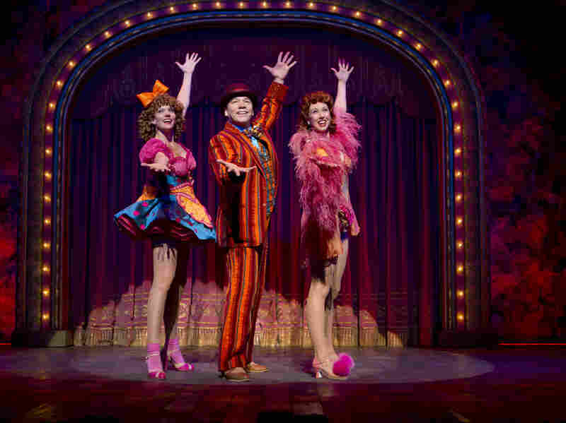 """Blue Man, Grouped: Buddy Plummer (Danny Burstein, with Jenifer Foote and Kiira Schmidt) gets to bust loose at last with """"Buddy's Blues"""" in the show's final sequence, known as Loveland."""