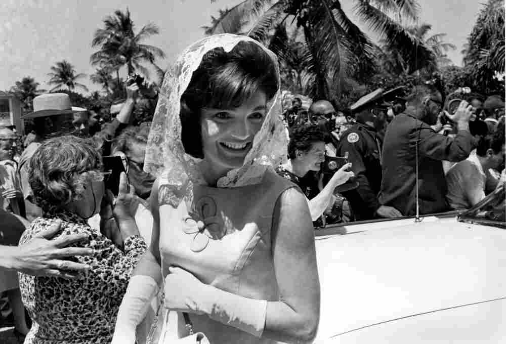 U.S. first lady Jacqueline Kennedy smiles as she leaves a private Easter service at the Kennedy family home in Palm Beach Fla., on April 14, 1963.