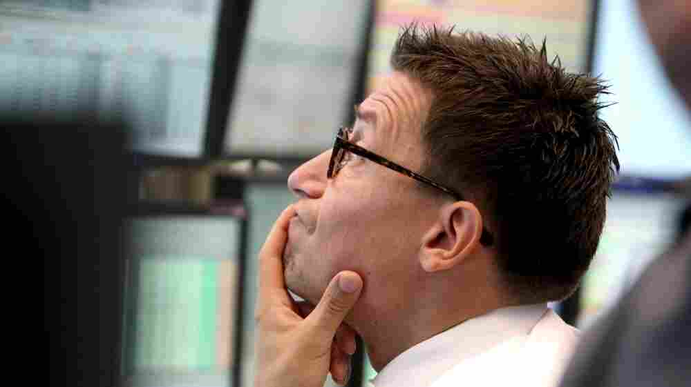 A trader watches his screens at the stock market in Frankfurt, Germany,  on Monday, when the German stock index DAX dropped under 5,000 points.