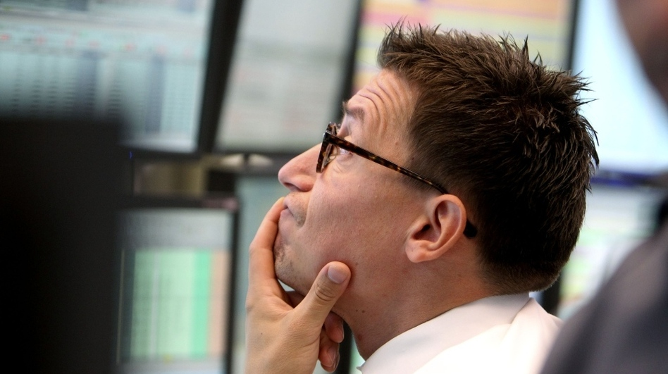 A trader watches his screens at the stock market in Frankfurt, Germany,  on Monday, when the German stock index DAX dropped under 5,000 points. (AP)