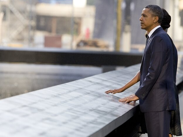 U.S. President Barack Obama and first lady Michelle Obama look out  at  the North Pool of the 9/11 Memorial during the tenth anniversary  ceremonies of the September 11, 2001 terrorist attacks at the World  Trade Center site.