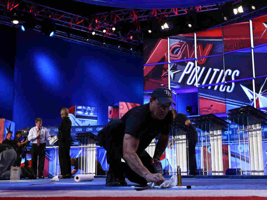A worker cleans the stage for Monday evening's Republican presidential debate sponsored by CNN and the Tea Party Express, Sept. 12, 2011.