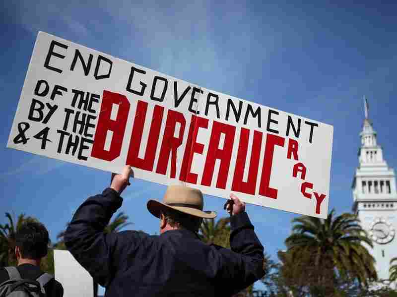 An activist holds a sign during a tax day Tea Party rally on April 15,  2011 in San Francisco, California. Tea Party activists staged tax day  rallies across the nation.