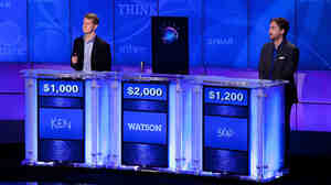 """Jeopardy!"" contestants Ken Jennings and Brad Rutter compete against Watson a"