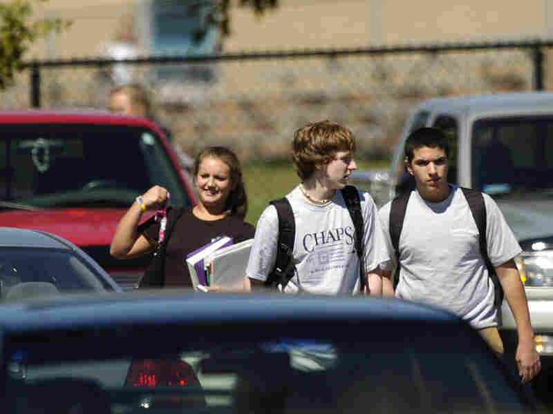 Students walk to their cars after school at Severna Park High School in Severna Park, Md. Researchers say tougher licensing laws have led to fewer fatal car crashes involving 16-year-old drivers.