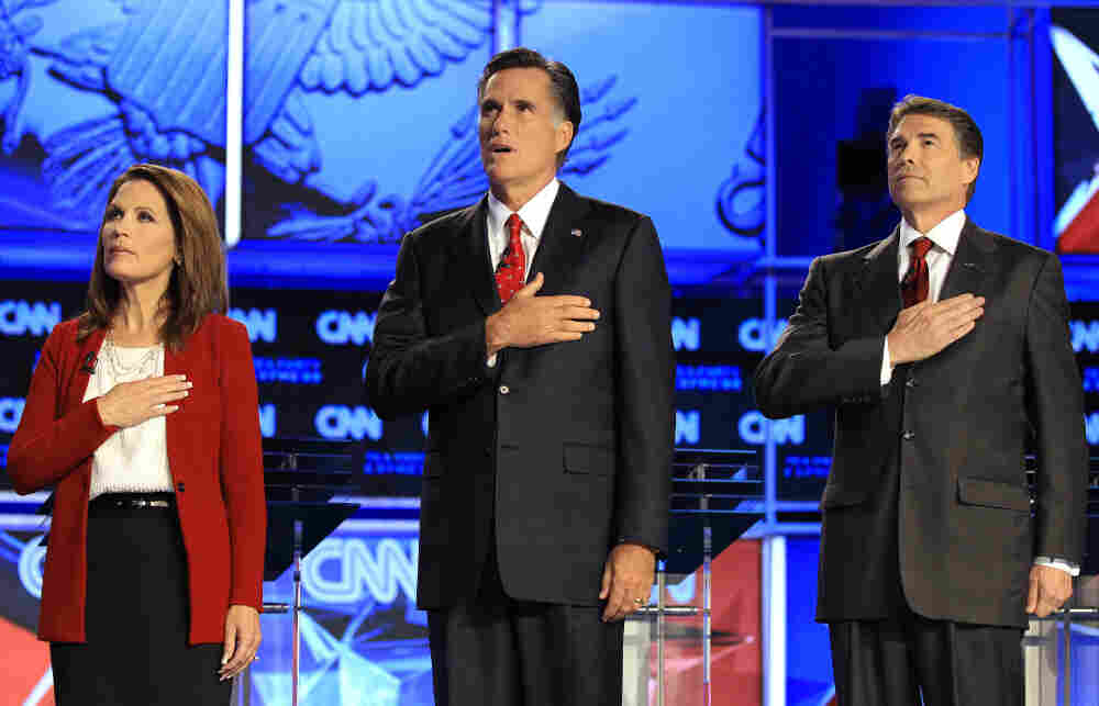 Republican presidential candidates, from left, Rep. Michele Bachmann, Mitt Romney and Texas Gov. Rick Perry, Sept. 12, 2011.