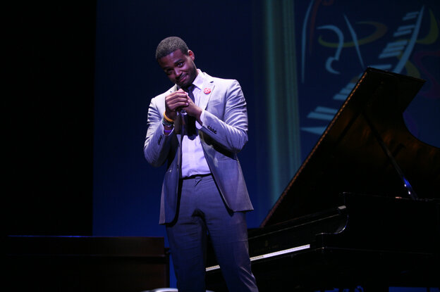Kris Bowers bows to the audience after performing in the Thelonious Monk International Jazz Piano Competition. He took home first prize.