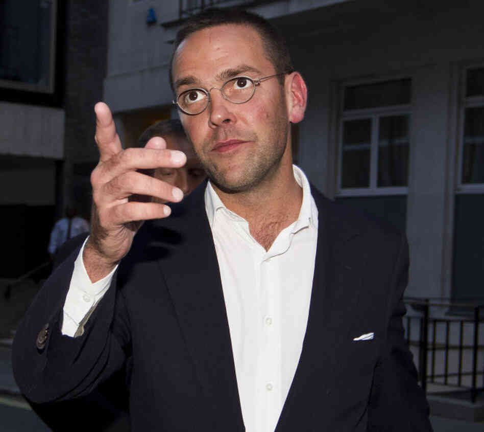 James Murdoch gesturing as he leaves h